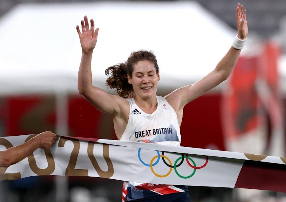 Kate French of Britain crosses the finish line.
