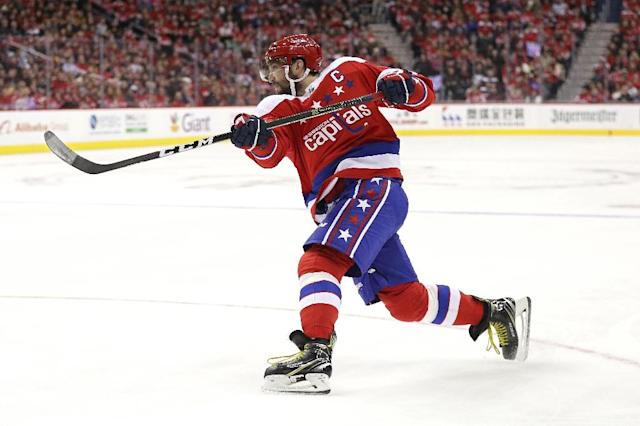 Washington Capitals star Alex Ovechkin has scored 30 goals for a 14th consecutive season to start his NHL career, one shy of Mike Gartner's career record (AFP Photo/Patrick Smith)