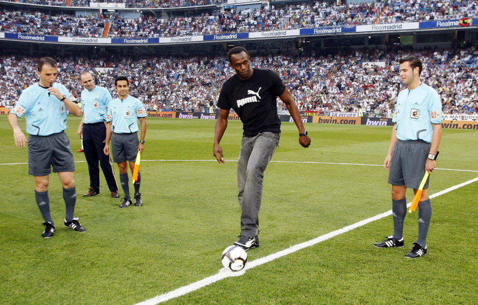 Usain Bolt before a Real Madrid game. He has always dreamed of playing soccer, specifically for Manchester United. (Getty)