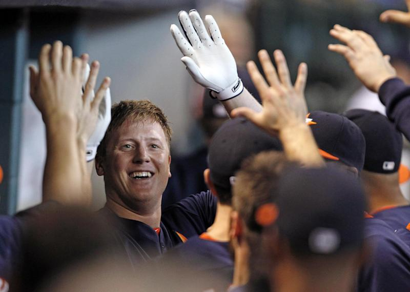 Houston Astros's Marc Krauss celebrates with teammates in the dugout after hitting a solo home run in the second inning of a baseball game against the Los Angeles Angels Sunday, Sept. 15, 2013, at Minute Maid Park in Houston. (AP Photo/Eric Christian Smith)