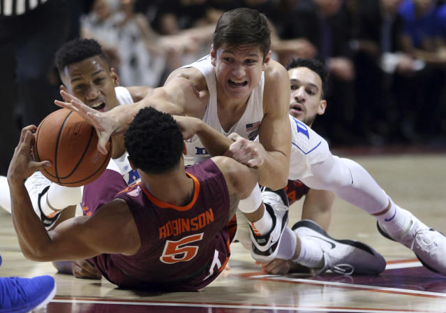 "Duke's <a class=""link rapid-noclick-resp"" href=""/ncaab/players/126159/"" data-ylk=""slk:Grayson Allen"">Grayson Allen</a> (3) reaches for the ball on top of Virginia Tech's <a class=""link rapid-noclick-resp"" href=""/ncaab/players/121851/"" data-ylk=""slk:Justin Robinson"">Justin Robinson</a> (5) during the first half of an NCAA college basketball game Monday, Feb. 26, 2018, in Blacksburg, Va. (Matt Gentry/The Roanoke Times via AP)"
