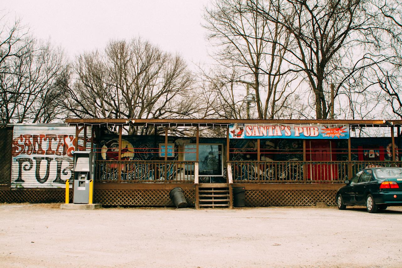 """<p><strong>So, this place looks interesting.</strong><br> It is. Santa's is a smoke-filled, double-wide trailer bedazzled in Christmas decor. It's unabashedly kitschy, and its regulars unabashedly hipster.</p> <p><strong>Hipsters you say?</strong><br> Santa's is full of twenty-somethings, college students and plenty of younger country artists, both big names and newcomers and they keep this double-wide packed from wing to wing. The owner, """"Santa,"""" has become somewhat of a local legend and has a legion of fans, both natives and out-of-towners.</p> <p><strong>How are the drinks?</strong><br> Did we mention Santa's is a double-wide? It should come as no surprise that PBR is the drink of choice here. And at $2 a pop, who could blame a broke college student?</p> <p><strong>Worth ordering something to eat, too?</strong><br> There's no food. No liquor. No wine. Just karaoke, cheap beer and a damn good time.</p> <p><strong>Did the staff do you right?</strong><br> The bar staff isn't rude, but it's busy every night of the week and they have a lot of people to get to, and their attitude reflects that.</p> <p><strong>Wrap it up: what are we coming here for?</strong><br> Love karaoke? Want to feel the musical talent that pulses through Nashville? <em>That's</em> why you come to Santa's. In a city that's become populated by cover charges, it's nice to know there's still somewhere to go for a cheap (or free) good time. It's cash only, and there's a house band every Sunday night from 7 p.m. to 9 p.m.</p>"""