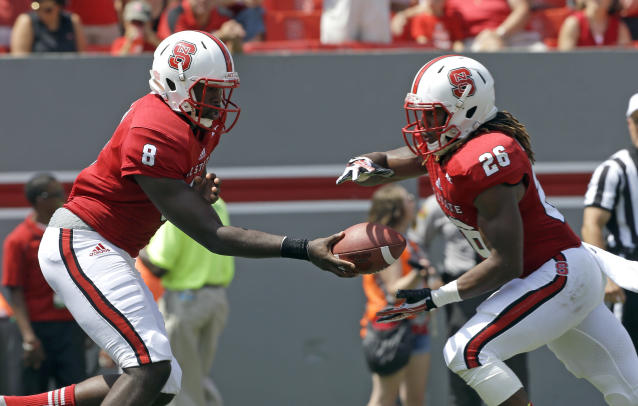 North Carolina State quarterback Brandon Mitchell (8) hands off to Tony Creecy (26) during the first half of an NCAA college football game against Louisiana Tech in Raleigh, N.C., Saturday, Aug. 31, 2013. (AP Photo/Gerry Broome)
