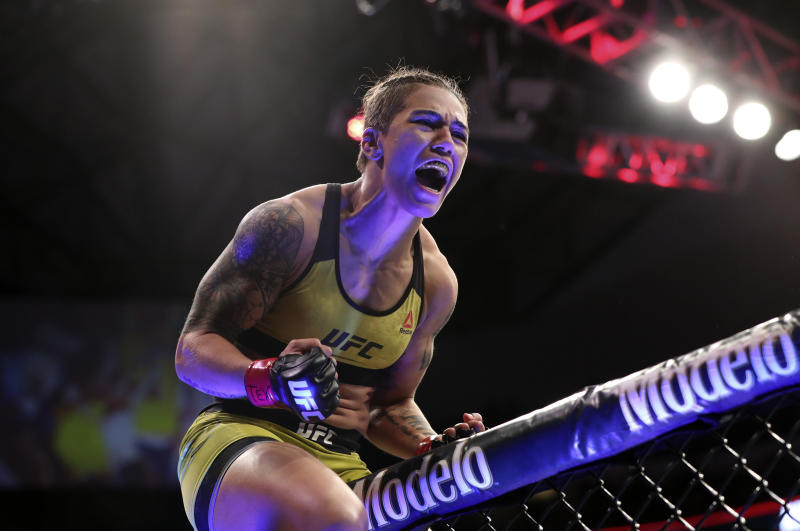 Sep 8, 2018; Dallas, TX, USA; Jessica Andrade (red gloves) reacts after defeating Karolina Kowalkiewicz (not pictured) during UFC 228 at American Airlines Center. Mandatory Credit: Kevin Jairaj-USA TODAY Sports