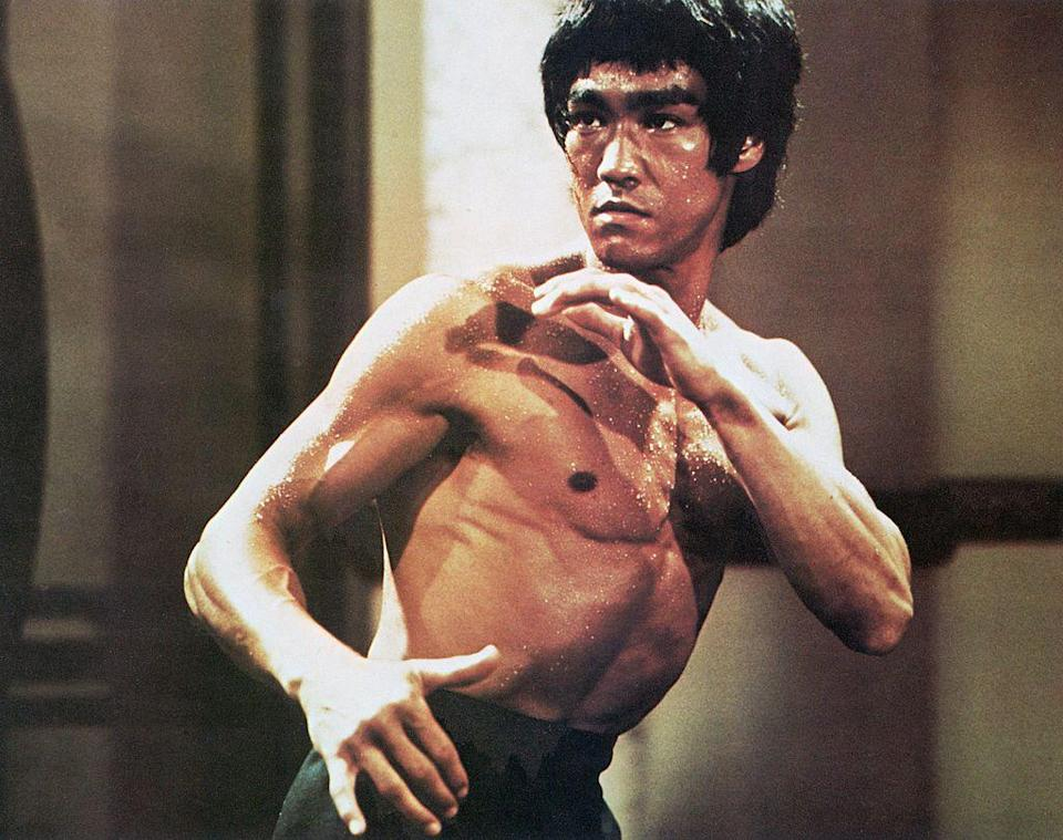 "<p>There's been <a href=""https://www.menshealth.com/entertainment/a28551411/bruce-lee-daughter-once-upon-a-time-in-hollywood-shannon/"" rel=""nofollow noopener"" target=""_blank"" data-ylk=""slk:plenty of controversy"" class=""link rapid-noclick-resp"">plenty of controversy </a>over Lee's characterization in Tarantino's <em>Once Upon a Time in Hollywood</em>. But 5'9"" actor <a href=""https://www.menshealth.com/fitness/a28425659/meet-mike-moh-the-new-bruce-lee/"" rel=""nofollow noopener"" target=""_blank"" data-ylk=""slk:Mike Moh"" class=""link rapid-noclick-resp"">Mike Moh</a> got the physique pretty dang close.</p>"