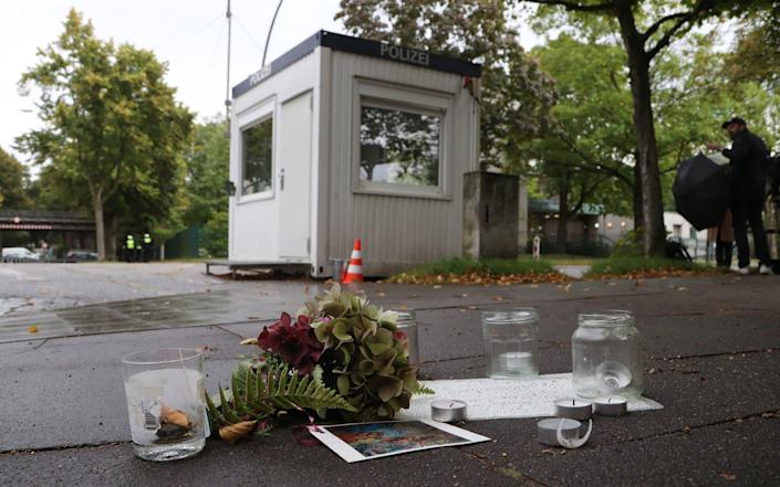 Candles and flowers in front of the synagogue of Eimsbuettel in Hamburg - FOCKE STRANGMANN/EPA-EFE/Shutterstock
