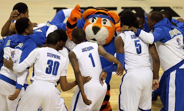 AUBURN HILLS, MI - MARCH 21: Players for the Memphis Tigers huddle around their mascot as they get set to play against the St. Mary's Gaels during the second round of the 2013 NCAA Men's Basketball Tournament at at The Palace of Auburn Hills on March 21, 2013 in Auburn Hills, Michigan. (Photo by Jonathan Daniel/Getty Images)