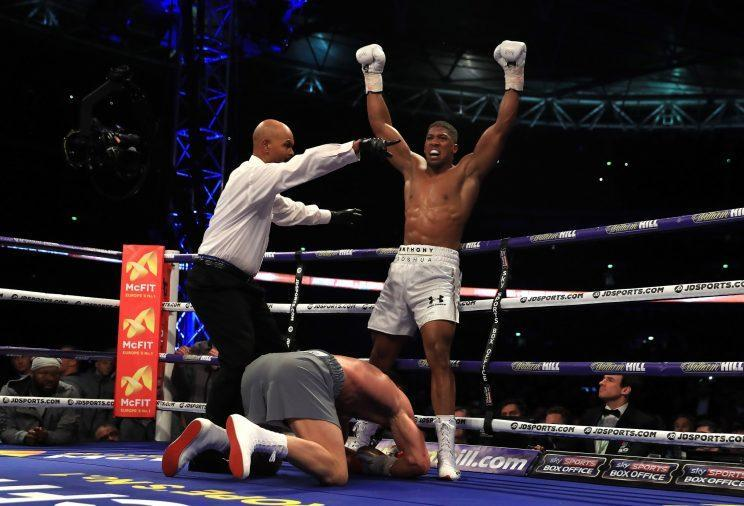 Anthony Joshua celebrates after knocking down Wladimir Klitschko in the 11th round Saturday as referee David Fields sends him to a neutral corner. (Getty Images)