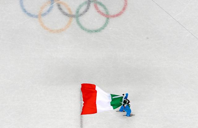 "Short Track Speed Skating Events – Pyeongchang 2018 Winter Olympics – Women's 500m Final – Gangneung Ice Arena - Gangneung, South Korea – February 13, 2018 - Arianna Fontana of Italy carries an Italian national flag while celebrating her victory. REUTERS/Lucy Nicholson SEARCH ""OLYMPICS BEST"" FOR ALL PICTURES. TPX IMAGES OF THE DAY."