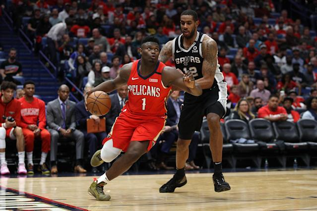 Zion Williamson of the New Orleans Pelicans drives the ball around LaMarcus Aldridge of the San Antonio Spurs at Smoothie King Center on Wednesday night. (Chris Graythen/Getty Images)