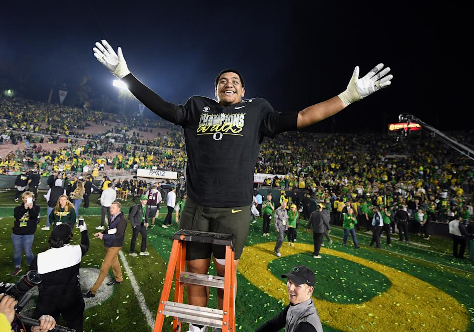 If all goes well for Penei Sewell on the first night of the NFL draft, his smile will be even bigger than when the Ducks defeated Wisconsin to become the 2020 Rose Bowl Champions. (Photo by John Cordes/Getty Images)