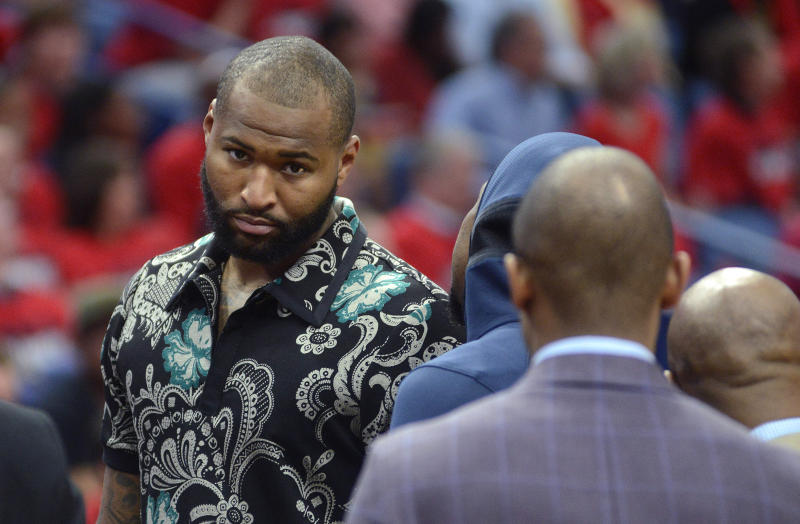 FILE - In this Thursday, April 19, 2018, file photo, New Orleans Pelicans center DeMarcus Cousins walks on the court in street clothes during the first half of Game 3 of the team's first-round NBA basketball playoff series against the Portland Trail Blazers in New Orleans. When Cousins comes back from his Achilles injury, the Golden State Warriors could have five players from the 2018 All-Star Game in their starting lineup. (AP Photo/Veronica Dominach, File)