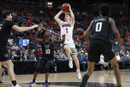 Arizona's Nico Mannion (1) shoots over Washington's Elijah Hardy (10) during the second half of an NCAA college basketball game in the first round of the Pac-12 men's tournament Wednesday, March 11, 2020, in Las Vegas. (AP Photo/John Locher)