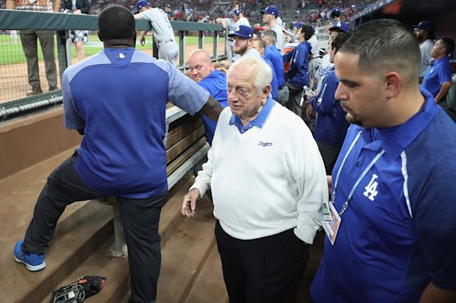 "Former Dodgers manager Tommy Lasorda stands in the dugout before Game Three of the 2018 National League Division Series between the Dodgers and Atlanta Braves. <span class=""copyright"">(Rob Carr / Getty Images)</span>"