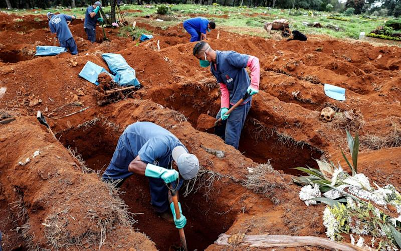 Gravediggers of the Vila Formosa cemetery, the largest in Latin America, exhume old graves to open new spaces for those deceased - Sebastiao Moreira/EPA-EFE/Shutterstock