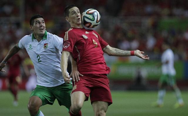 Spain's Fernando Torres, right, and Bolivia's Ronald Equino, left, vie for the ball during their friendly soccer match in Seville, on Friday, May 30. 2014. (AP Photo/Miguel Angel Morenatti)