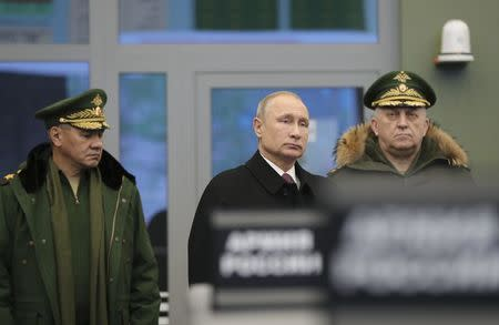 Russian President Putin and Defence Minister Shoigu visit the Military Academy of the Strategic Missile Forces outside Moscow