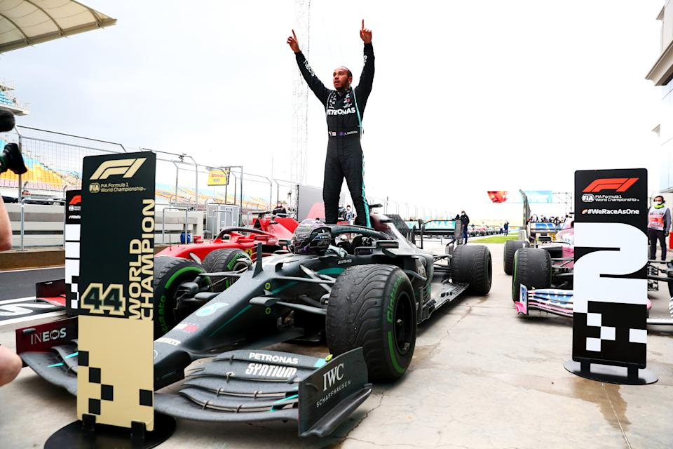 Race winner Lewis Hamilton of Great Britain and Mercedes GP celebrates winning a 7th F1 World Drivers Championship in parc ferme during the F1 Grand Prix of Turkey at Intercity Istanbul Park on November 15, 2020 in Istanbul, Turkey.