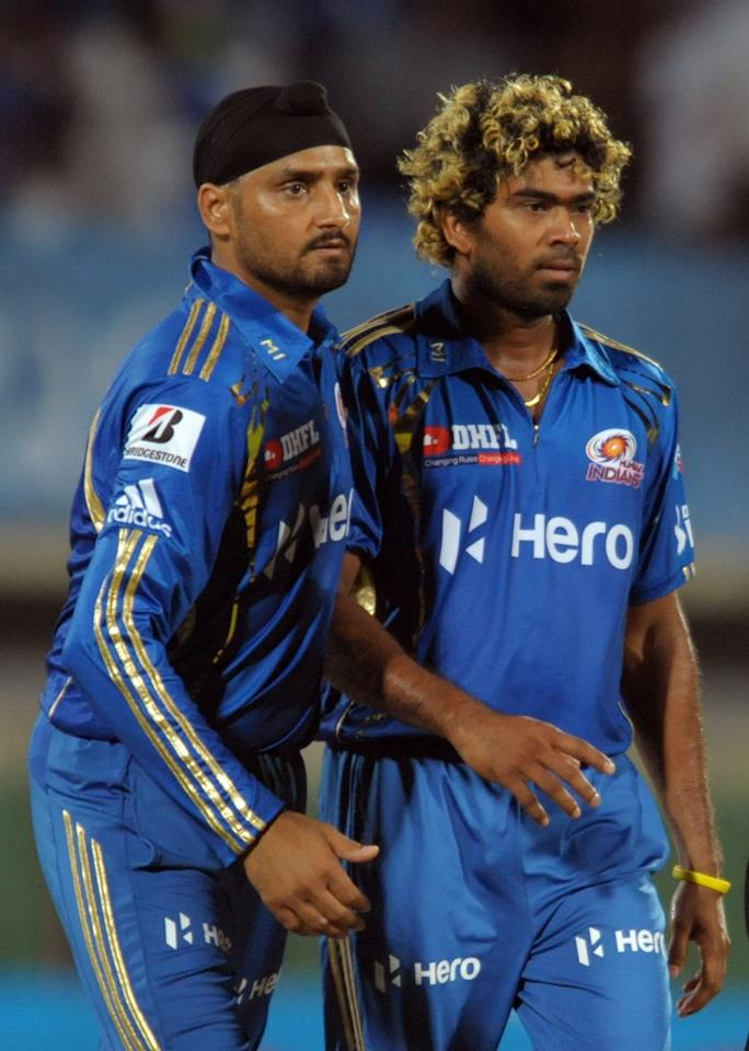 Mumbai Indians bowler Latish Malinga(R) celebrates with captain Harbhajan Singh  the wicket of Deccan Chargers Ravi Teja during the IPL Twenty20 cricket match between Deccan Chargers and Mumbai Indians at Dr. Y.S. Rajasekhara Reddy Cricket Stadium in Visakhapatnam on April 9, 2012. AFP PHOTO / Noah SEELAM.RESTRICTED TO EDITORIAL USE. MOBILE USE WITHIN NEWS PACKAGE. . (Photo credit should read NOAH SEELAM/AFP/Getty Images)