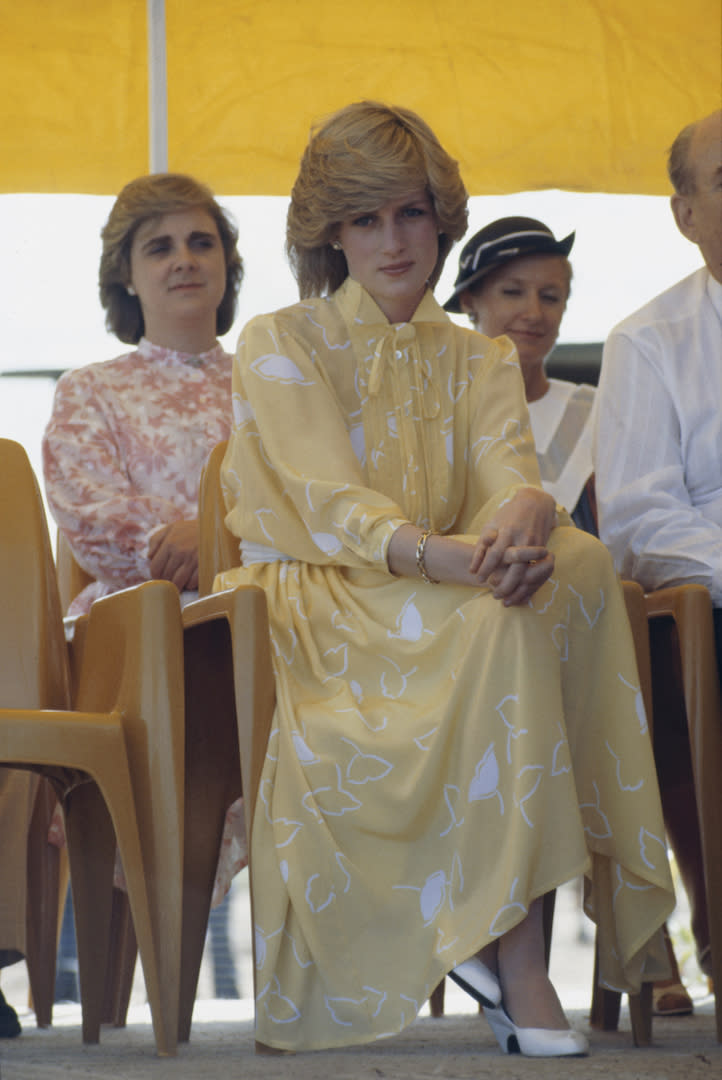 Princess Diana chose a sunny pussy-bow dress by Jan van Velden to kickstart the Royal Tour of Australia at Alice Springs Airport in 1983. <em>[Photo: Getty]</em>