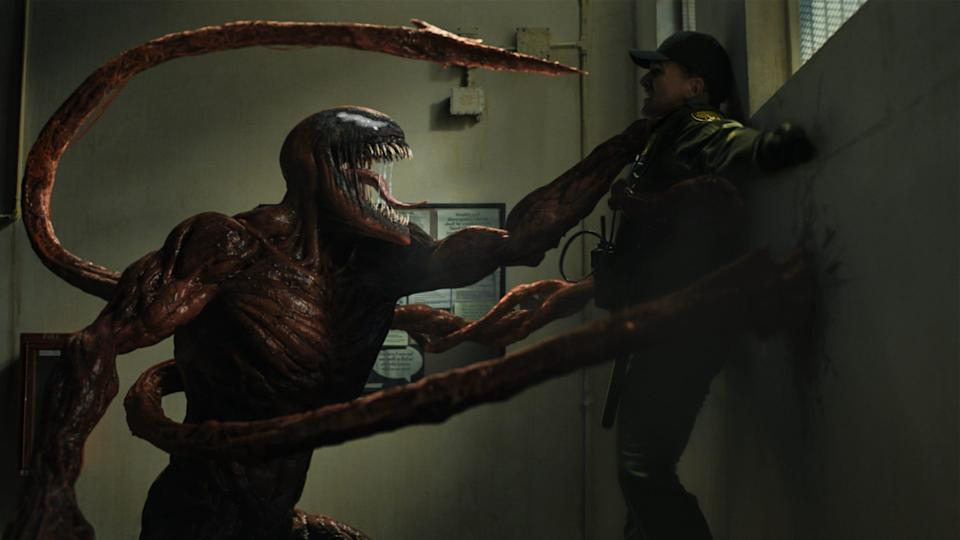 """The villainous Carnage roughs up a security guard in the superhero sequel """"Venom: Let There Be Carnage."""""""