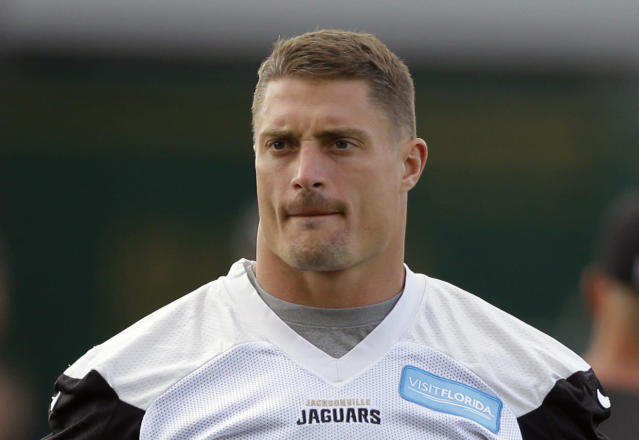 FILE - In this Sept. 30, 2016, file photo, Jacksonville Jaguars linebacker Paul Posluszny takes part in an NFL practice session at the Allianz Park rugby stadium in London. Posluszny formally and reluctantly retired Monday, April 16, 2018, after 11 seasons in the league, including the last seven in Jacksonville. He finished his career with 1,381 tackles, 41 pass breakups, 16 sacks, 15 interceptions and eight forced fumbles. (AP Photo/Alastair Grant, File)