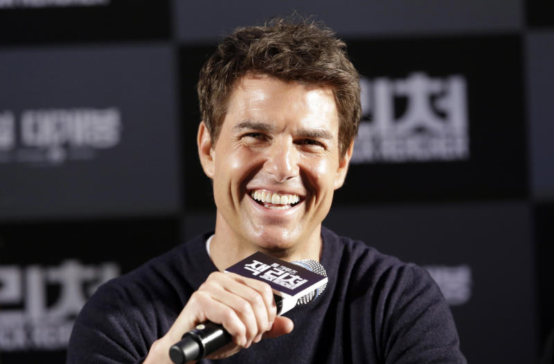 """U.S. actor Tom Cruise answers reporters' questions during a news conference to promote his film """"Jack Reacher"""" in Seoul, South Korea, Thursday, Jan. 10, 2013. Even though he turned 50 last summer and has been a Hollywood star for three decades, Tom Cruise says he still has fun making movies. (AP Photo/Lee Jin-man)"""