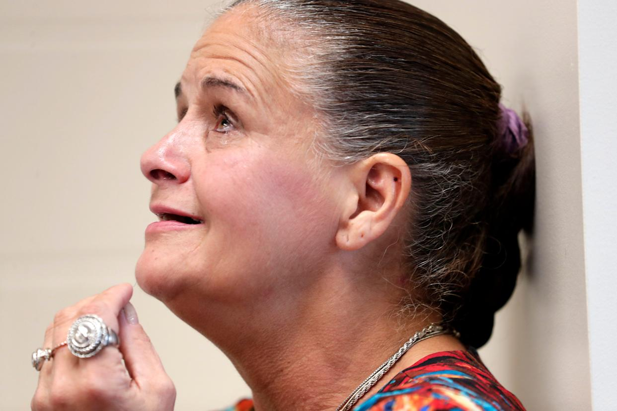 Teresa Odom, who was arrested last year by former Jackson County deputy Zach Wester, sheds a tear at a news conference Wednesday, July 10, 2019, in Marianna, Fla. Her charges were dropped after allegations against Wester came to light.
