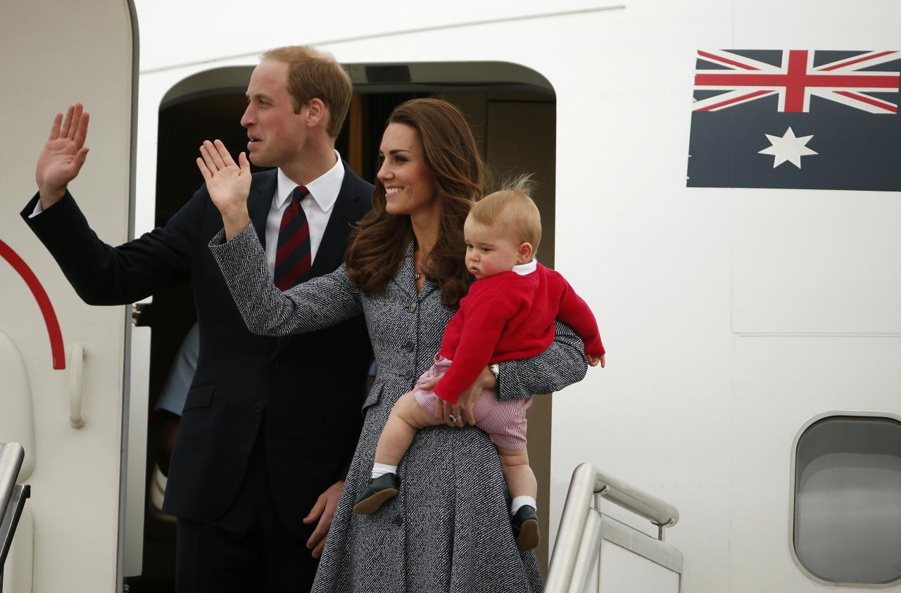Britain's Catherine, the Duchess of Cambridge, waves with her husband Prince William, as she holds her son Prince George before they depart Canberra April 25, 2014. The Prince and his wife Kate are undertaking a 19-day official visit to New Zealand and Australia with their son Prince George. REUTERS/Phil Noble (AUSTRALIA - Tags: ROYALS ENTERTAINMENT POLITICS TPX IMAGES OF THE DAY)