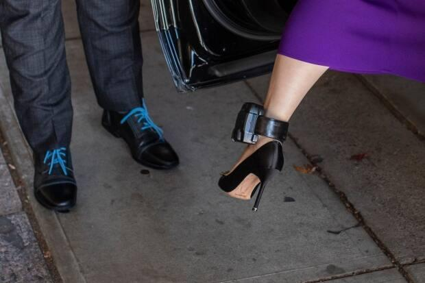 Huawei chief financial officer Meng Wanzhou emerges from her vehicle at B.C. Supreme Court in October 2020. She wears a GPS-monitoring bracelet on her ankle as part of her bail conditions.