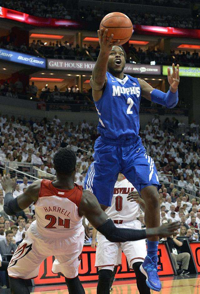 Memphis' Shaq Goodwin, right, shoots over the attempted block of Louisville's Montrezl Harrell during the first half of an NCAA college basketball game on Thursday Jan. 9, 2014, in Louisville, Ky. (AP Photo/Timothy D. Easley)