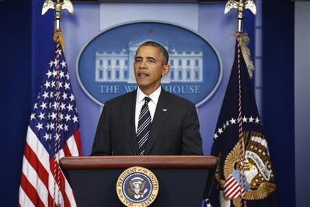 U.S. President Obama pauses while speaking from the Briefing Room of the White House in Washington