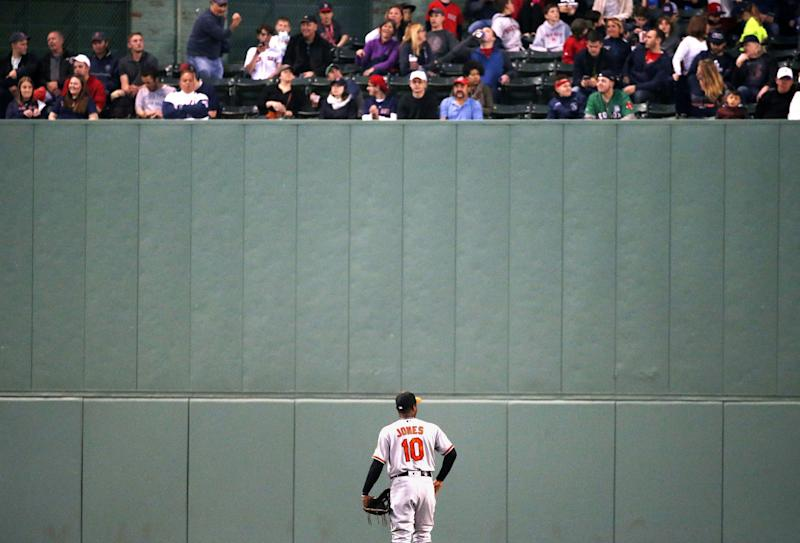Adam Jones looks up at fans in the third inning of Tuesday's game at Fenway Park. (AP)