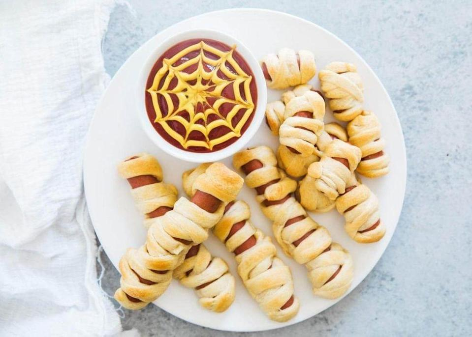 """<p>Two ingredients create these fun and festive little monsters. </p><p><a class=""""link rapid-noclick-resp"""" href=""""https://www.iheartnaptime.net/mummy-hot-dogs/"""" rel=""""nofollow noopener"""" target=""""_blank"""" data-ylk=""""slk:GET THE RECIPE"""">GET THE RECIPE</a></p>"""