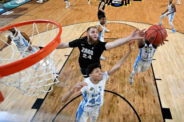 <p>Theo Pinson #1 of the North Carolina Tar Heels reaches for a rebound over Przemek Karnowski #24 of the Gonzaga Bulldogs during the 2017 NCAA Men's Final Four National Championship game at University of Phoenix Stadium on April 3, 2017 in Glendale, Arizona. (Photo by Chris Steppig/NCAA Photos via Getty Images) </p>
