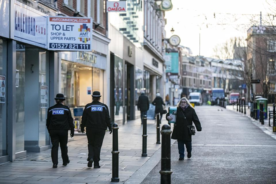 Two police officers patrol an empty High Street in Worcester city centre, Worcestershire, on the first day of the third national lockdown in England, to reduce the spread of COVID-19. Prime Minister Boris Johnson announced further coronavirus restrictions during a televised address to the nation last night.