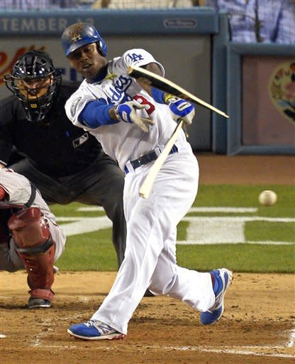 Los Angeles Dodgers' Hanley Ramirez breaks his bat as he grounds out during the fourth inning of their baseball game against the Arizona Diamondbacks, Thursday, Aug. 30, 2012, in Los Angeles. (AP Photo/Mark J. Terrill)