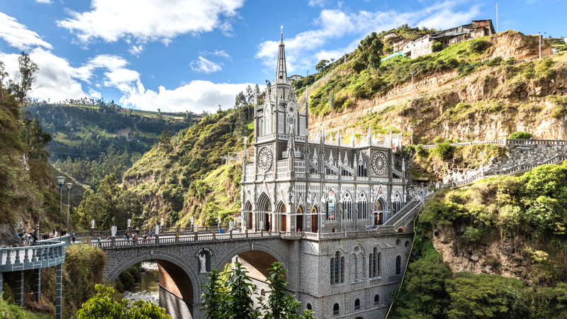 The Las Lajas Shrine in Columbia, a gothic building with gorgeous  spires located in a river canyon.