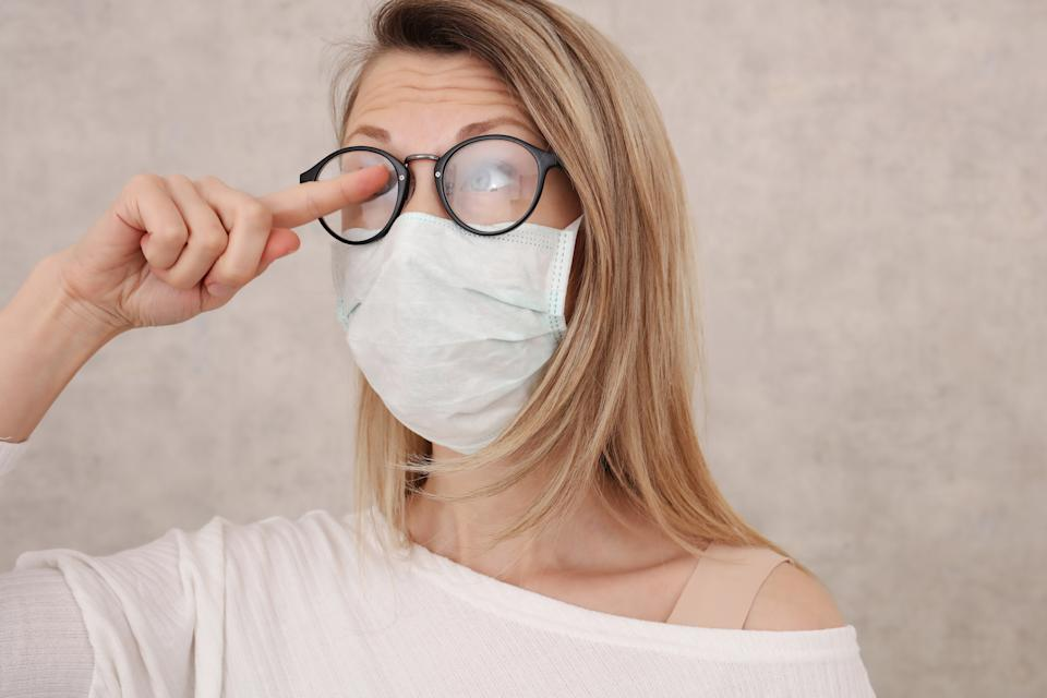 Face masks can cause your glasses to fog. (Posed by model, Getty Images)