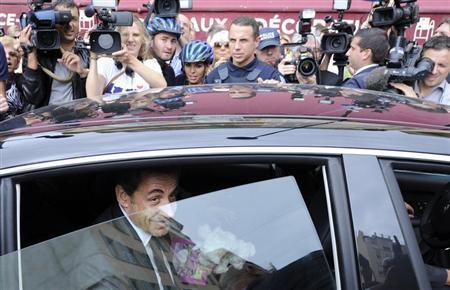 Former French president Nicolas Sarkozy leaves by car after a lunch with UMP political party members in Nice