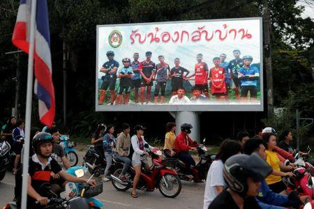 """A board showing """"Welcome home, boys"""", is seen after rescue effort has begun for the 12 schoolboys and their soccer coach trapped in Tham Luang cave, in Chiang Rai"""
