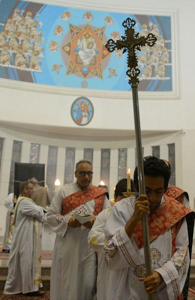 Clergymen attend Sunday Mass at Saint Mary's church in the Egyptian capital Cairo, on April 23, 2017, ahead of Pope Francis' visit