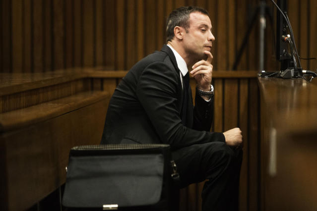 Oscar Pistorius sits in the dock on the fourth day of his trial at the high court in Pretoria, South Africa, Thursday, March 6, 2014. Pistorius is charged with murder for the shooting death of his girlfriend, Reeva Steenkamp, on Valentines Day in 2013. (AP Photo/Marco Longari, Pool)