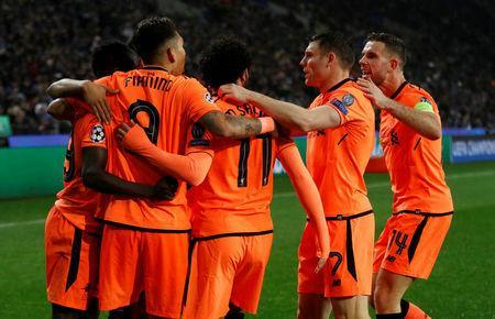 Soccer Football - Champions League Round of 16 First Leg - FC Porto vs Liverpool - Estadio do Dragao, Porto, Portugal - February 14, 2018 Liverpool's Sadio Mane celebrates scoring their third goal with Roberto Firmino and team mates Action Images via Reuters/Matthew Childs