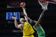Australia's Aron Baynes (12) and Nigeria's Ekpe Udoh (8) reach for a rebound during a men's basketball preliminary round game at the 2020 Summer Olympics, Sunday, July 25, 2021, in Saitama, Japan. (AP Photo/Eric Gay)
