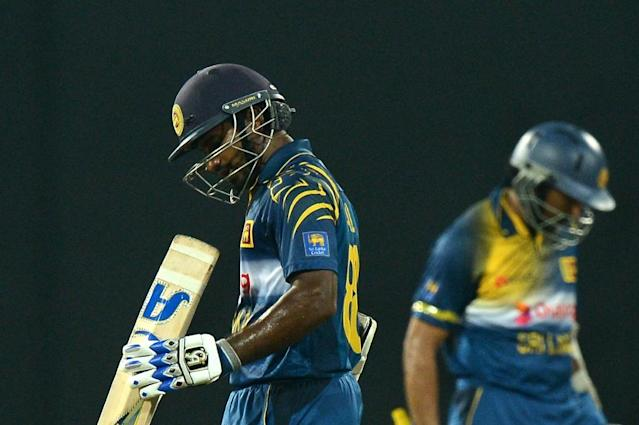 Sri Lankan cricketer Kusal Perera (L) was abruptly pulled from the New Zealand series after failing a drugs test (AFP Photo/Lakruwan Wanniarachchi)
