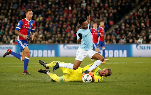 Soccer Football - Champions League - Basel vs Manchester City - St. Jakob-Park, Basel, Switzerland - February 13, 2018 Manchester City's Raheem Sterling in action with Basel's Tomas Vaclik Action Images via Reuters/Andrew Boyers
