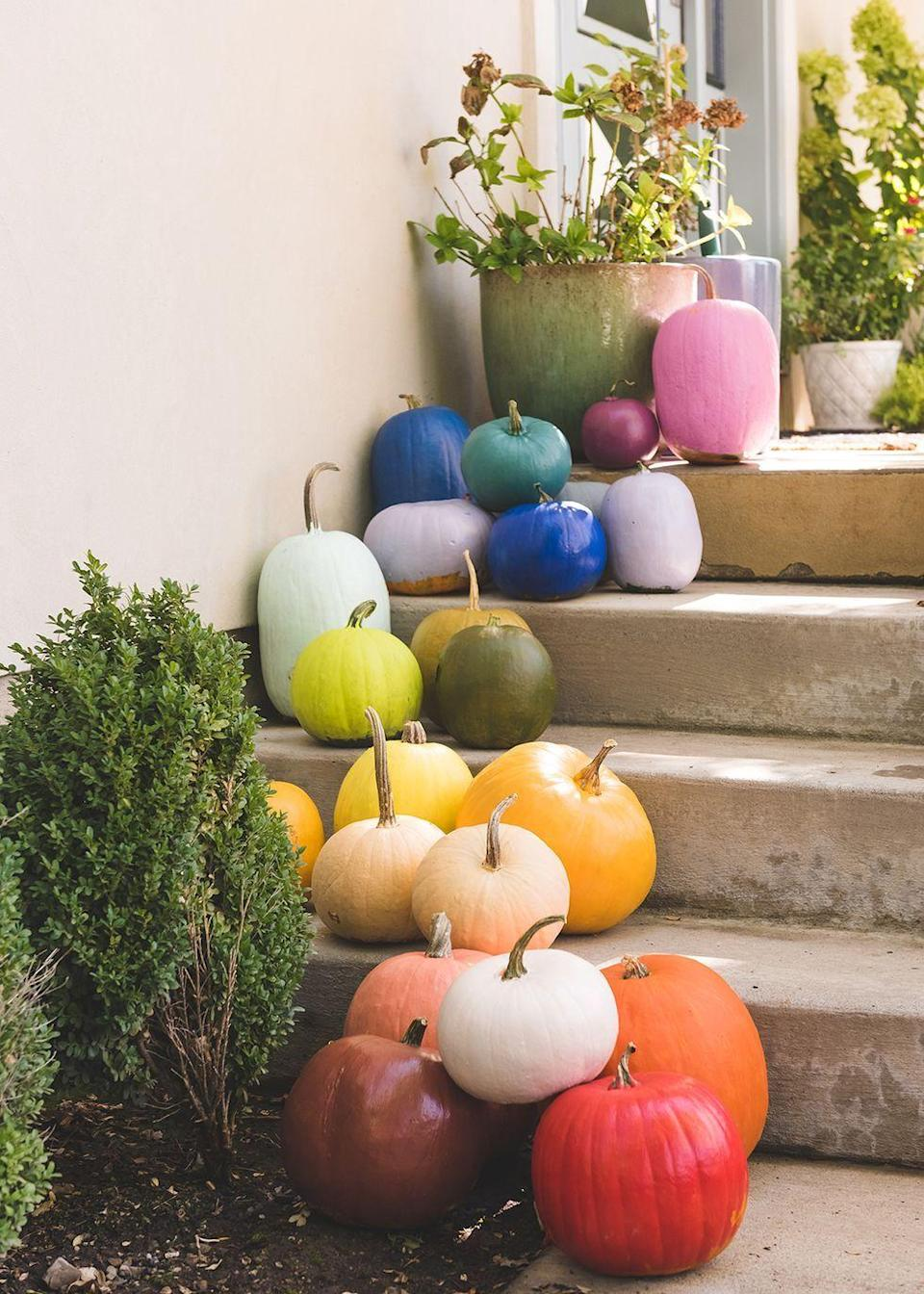 "<p>If you went a little overboard at the pumpkin patch and have a lot of pumpkins to work with, try painting each one a different color to create a chic rainbow effect. </p><p><em><a href=""https://thehousethatlarsbuilt.com/2018/10/diy-rainbow-pumpkins.html/"" rel=""nofollow noopener"" target=""_blank"" data-ylk=""slk:Get the tutorial at The House That Lars Built »"" class=""link rapid-noclick-resp"">Get the tutorial at The House That Lars Built »</a></em></p>"