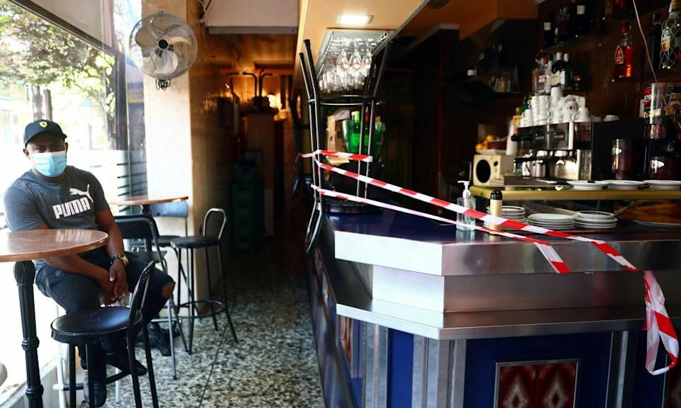 A bar counter is sealed off to prevent contact between customers at the Vallecas neighbourhood, amid the coronavirus outbreak in Madrid, Spain.