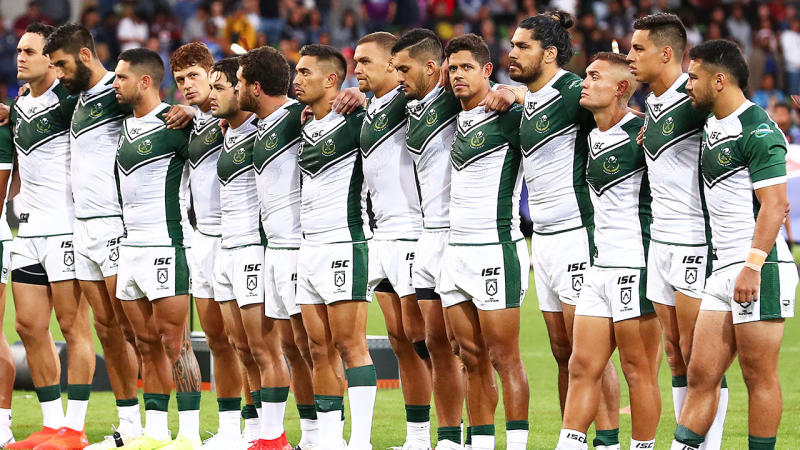 New Zealand Maori Kiwi players link arms during the national anthem.